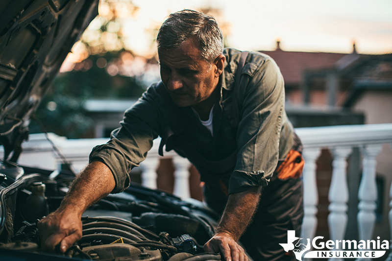 A man maintaining a vehicle he doesn't drive often