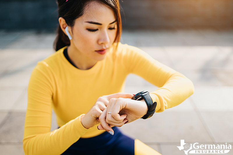 A woman using her fitness tracker during a workout