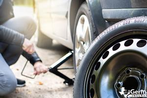 Going through the steps of how to change a flat tire