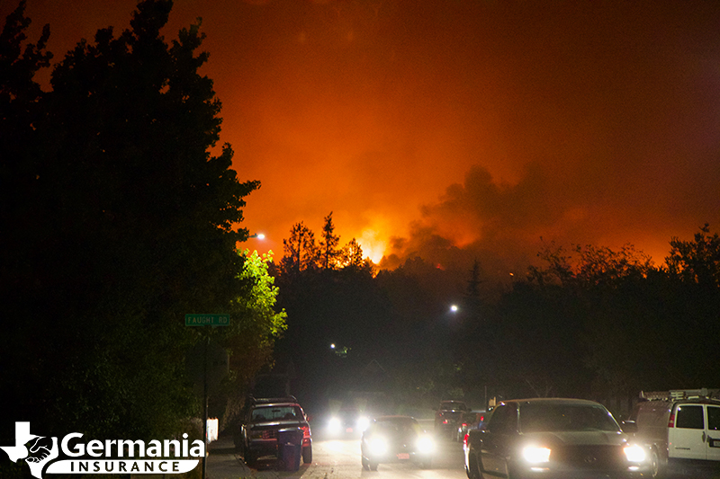 A series of cars evacuating from a wildfire