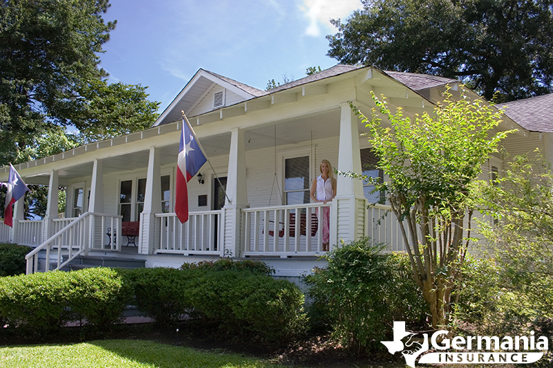 Woman standing on the porch of her new Texas home.