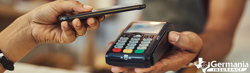 A smart phone being used to make a mobile payment using a digital wallet