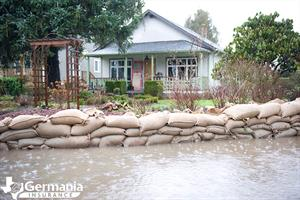 Sandbags in front of a home prepared for hurricane season.