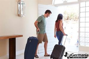 A couple leaving with suitcases after preparing their home for vacation