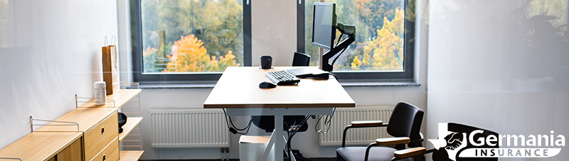 A standing desk surrounded by chairs