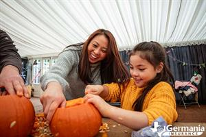 Mother and daughter decorating pumpkins - fall activities in Texas