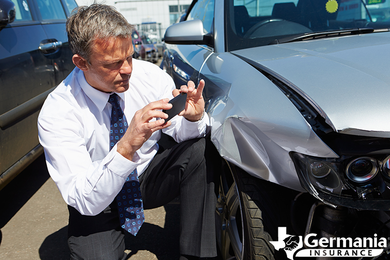 An insurance claims adjuster evaluating an auto claim