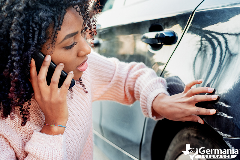 A woman filing an insurance claim for an auto accident